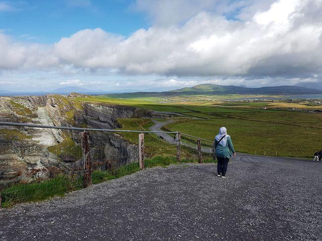 Enjoying fresh air at Kerry cliffs. Landscape Travel People Calm Fresh Air.  Nature Kerry Cliffs Kerry Ireland Sky Cloud - Sky Shore Fence