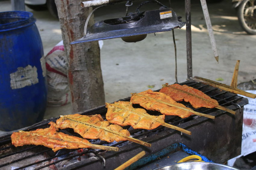 Grilled Chicken Grilled Chicken .Thailand Food Style Metal Industry Machinery Equipment Day Indoors  Focus On Foreground Occupation Working No People Technology Heat - Temperature Close-up Orange Color Workshop Mode Of Transportation Work Tool Car Wheel