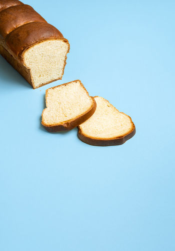 High angle view of bread against blue background