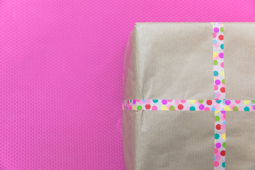 Birthday parcel from best friend on pink background Birthday Present Celebration Copy Space Gift Box Part Of Adhesive Tape Birthday Close-up Colored Background Day Decoration Geometric Shape Gift Indoors  Multi Colored No People Package Pattern Pink Background Pink Color Polka Dot Surprise Vibrant Color Wrapped Wrapping Paper