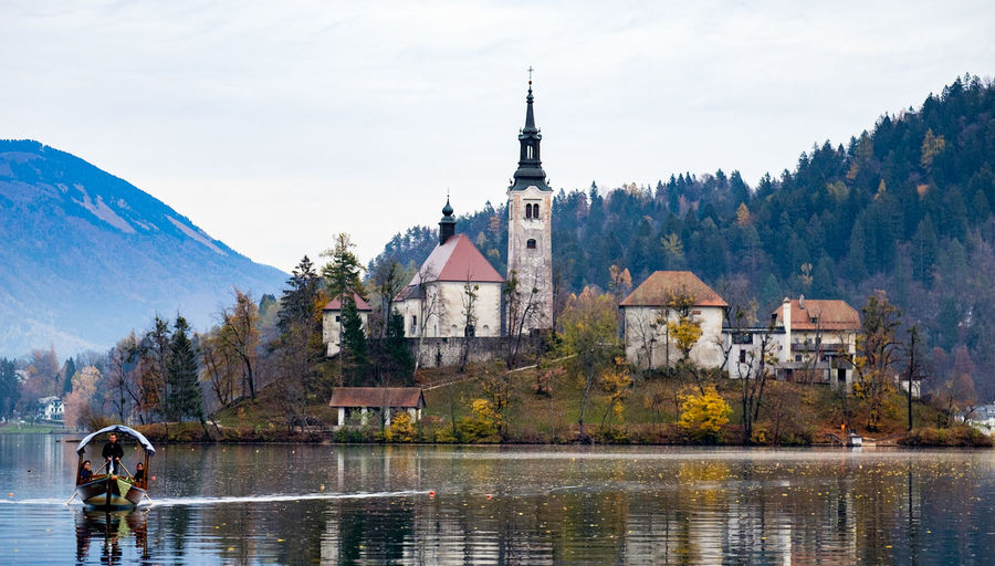 People On Boat Sailing In Lake Bled Against Church