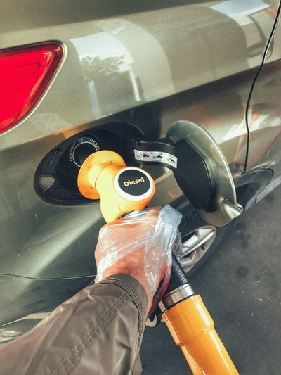 Human Hand Human Body Part One Person Personal Perspective Car Real People Land Vehicle Men Day Close-up Low Section Outdoors People Fuel And Power Generation Fueling Fuel Pump