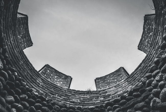 Look at inside up   Middle age sky Architecture B&w Battle Black And White Blackandwhite Building Exterior Built Structure Castle High Section Low Angle View Middle Age Middle Ages No People Residential Structure Round Stones Stonestructures Tower Up Wall War
