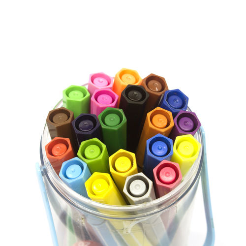 High angle view of multi colored pens against white background