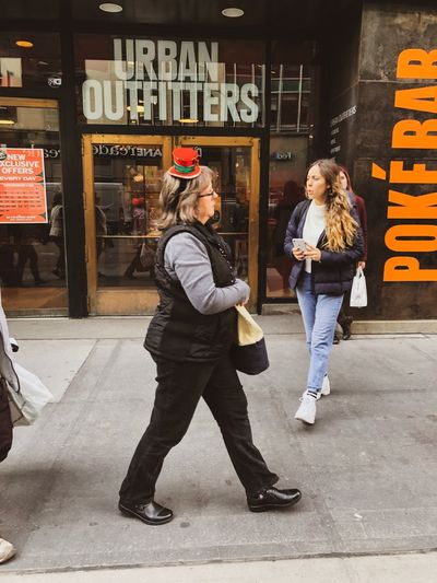 Urban Outfitters Christmas Decoration Christmastime Full Length City Casual Clothing Two People Real People Adult Young Adult Street Lifestyles Leisure Activity Walking Women People Building Exterior City Life