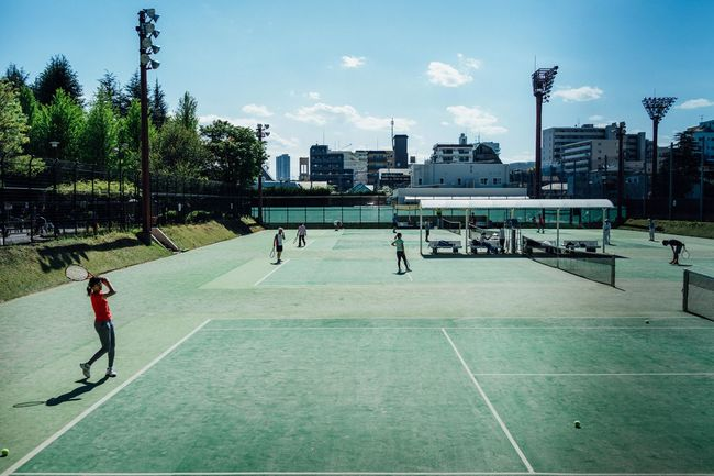 Adult Architecture Basketball - Sport Court Day Full Length Leisure Activity Lifestyles One Person Outdoors People Playing Real People Sky Sport Sportsman Tree