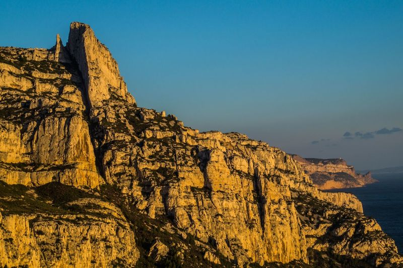 marseille,calanque,bouche du rhone, france Rock Sky Rock - Object Rock Formation Beauty In Nature Solid Nature Scenics - Nature Mountain Tranquility Cliff Tranquil Scene Clear Sky Mountain Range Non-urban Scene Rocky Mountains No People Geology Environment Physical Geography Formation Outdoors Eroded Mountain Peak Climate