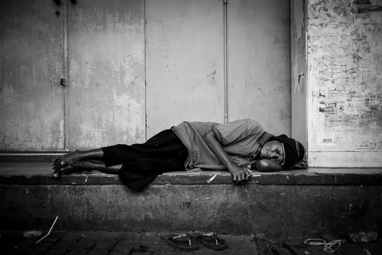 Man sleeping in abandoned house