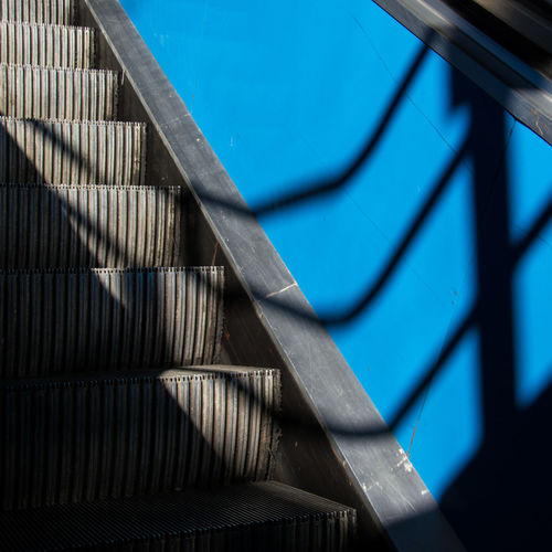 Creeping Shadow Blues Abstract Architecture Blue Blue Color Diagonal Escalator Shadows Shadows & Lights Stairs Urban Geometry Urban Lines TakeoverContrast The City Light Premium Collection The Graphic City