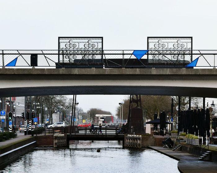 Bridges over the Zuidwillemsvaart Canal in Helmond The Netherlands Street Photography ArtWork Decoration People Pedestrians Traffic Traffic Lights Reflections December Hidden Gems