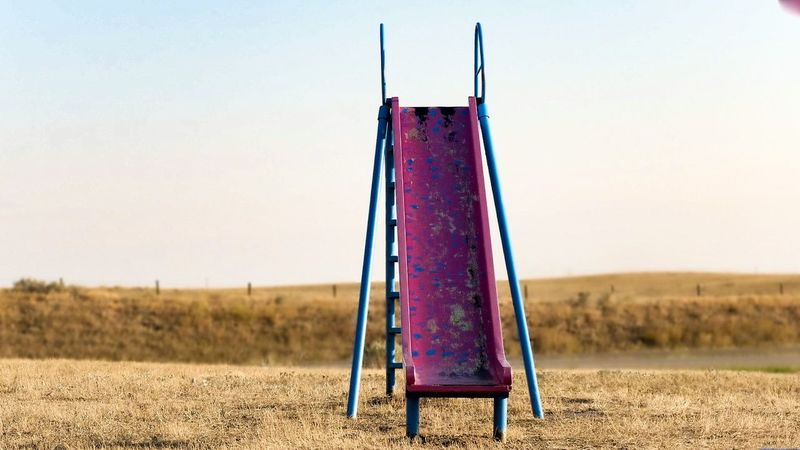 Playground Slide Remote Location Drought Prarie Hay Solotraveler Cycling Trip  Rural Scene No People Canada Coast To Coast Adventure Cloud - Sky