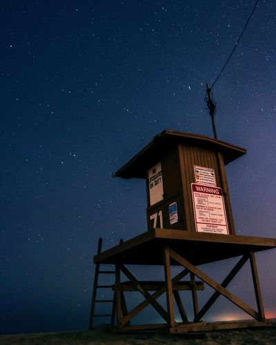 Low Angle View Of Lifeguard Hut Against Star Field