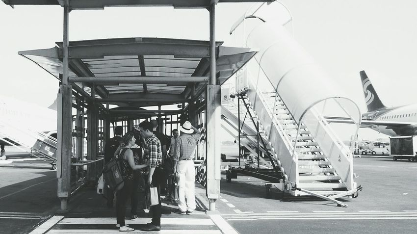Time to Say Goodbye: paikura © Monochrome Photography Black And White Bw_collection EyeEm Best Shots - Black + White Eye4photography  Travel AMPt_ Community Airport Two People Eye4photography  Airport Runway Outdoors Traveling Home For The Holidays
