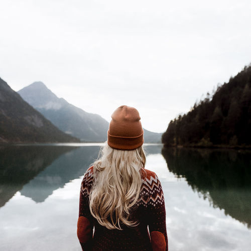 Water Rear View Lake Real People Lifestyles Leisure Activity Women Beauty In Nature Sky Adult Nature Day People Tranquil Scene Scenics - Nature Tranquility Reflection Mountain Non-urban Scene Hair Outdoors Hairstyle Looking At View