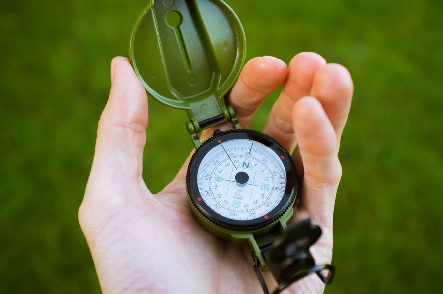 Adult Close-up Compass Expedition Holding Human Hand Lost Navigational Compass Orientation Outdoor Outdoors Survival Traveling Finding New Frontiers Live For The Story