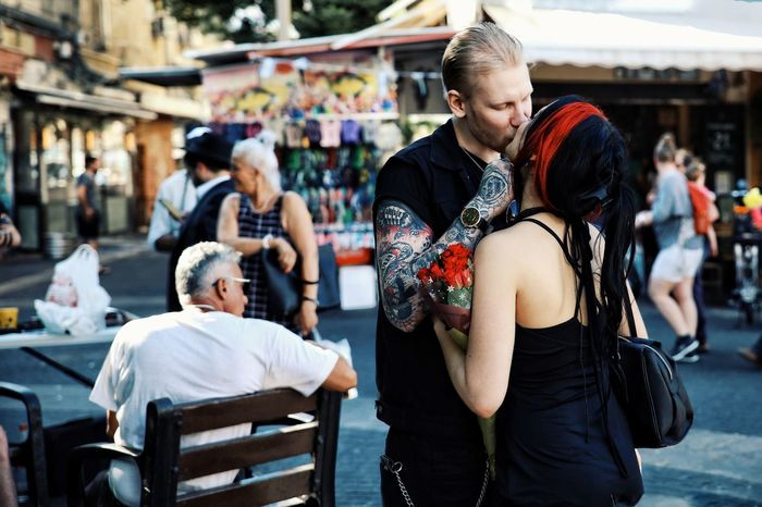 EyeEm Best Shots EyeEm Of The Week Kiss Couple Streetphotography Tattoo Friendship Men Arts Culture And Entertainment Incidental People Market