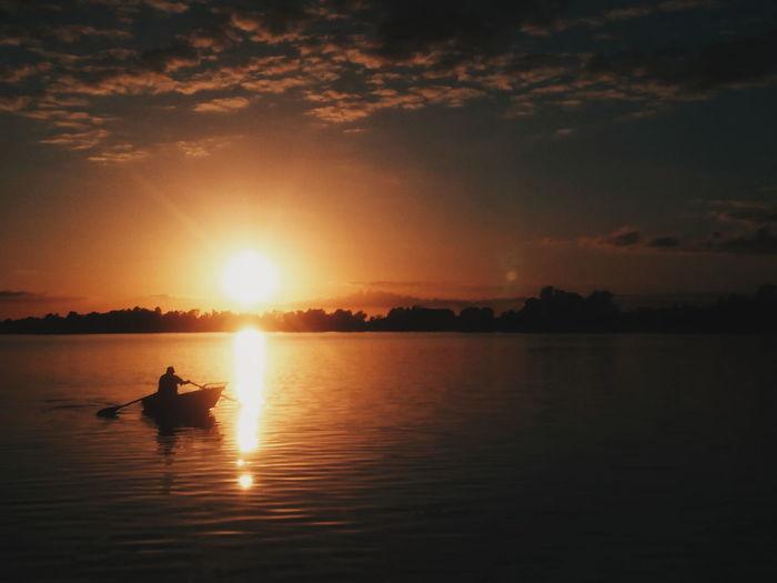 Rajgród, Poland. Sunset Silhouette Reflection Water Sunlight Nature People Outdoors Sun Vacations Beauty In Nature EyeEm Best Shots EyeEm Best Edits VSCO Summer Landscape Horizon Over Water Fishing Fisherman