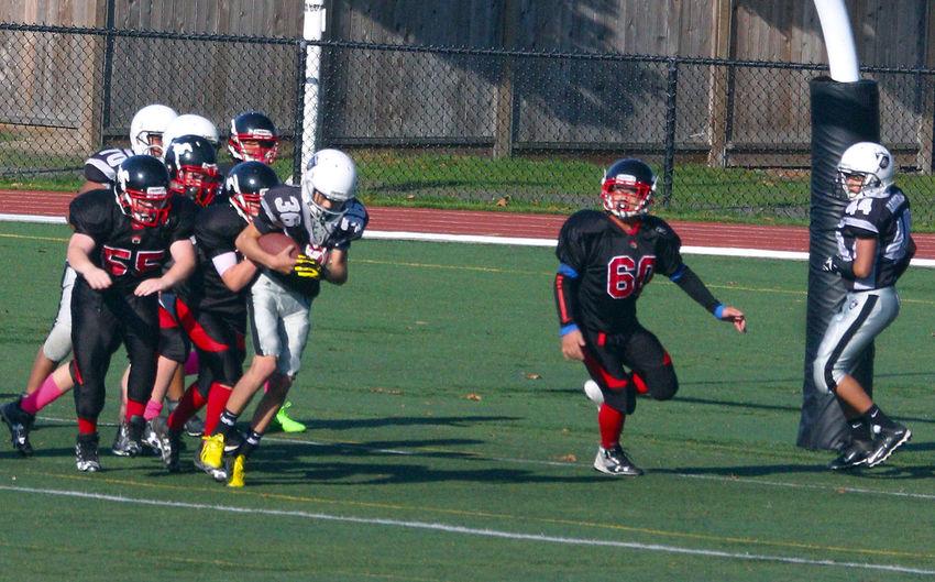 Junior Football in Minoru Park in Richmond B.C. Canada. Headwear Sport Sports Team Teamwork Sports Uniform Outdoors Football Helmet Junior Football Canada Richmond BC