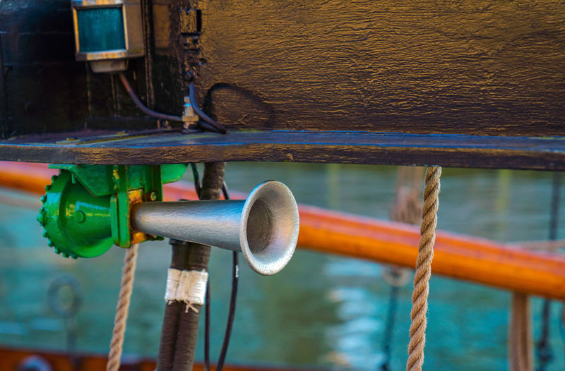 Close-up of megaphone tied on boat