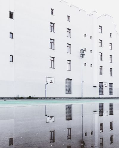 City Street Puddleography Puddle Minimalist Architecture Minimal Urban Warszawa  Streetphotography EyEmNewHere Warsaw Minimalism Building Exterior Architecture Built Structure Water Sky Building Day No People Clear Sky Window White Color Outdoors City Wall - Building Feature Residential District