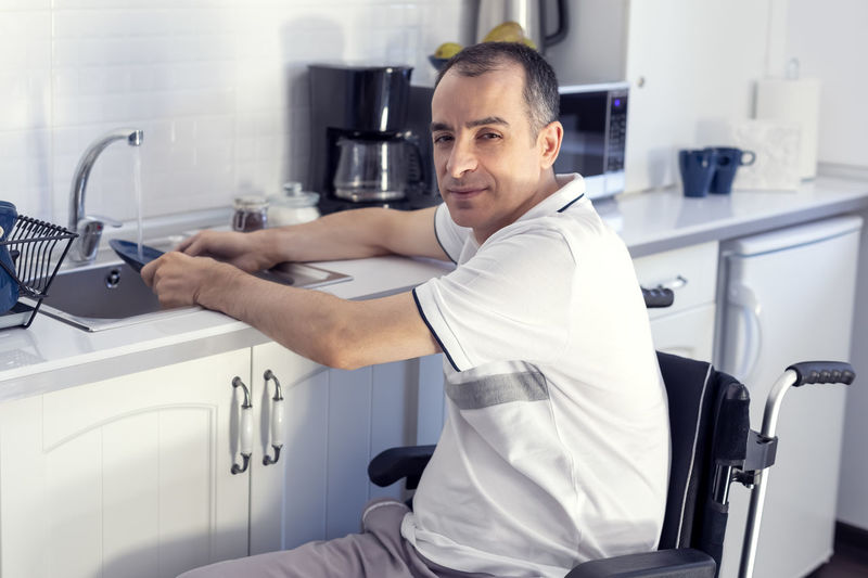 Mid adult man sitting at home