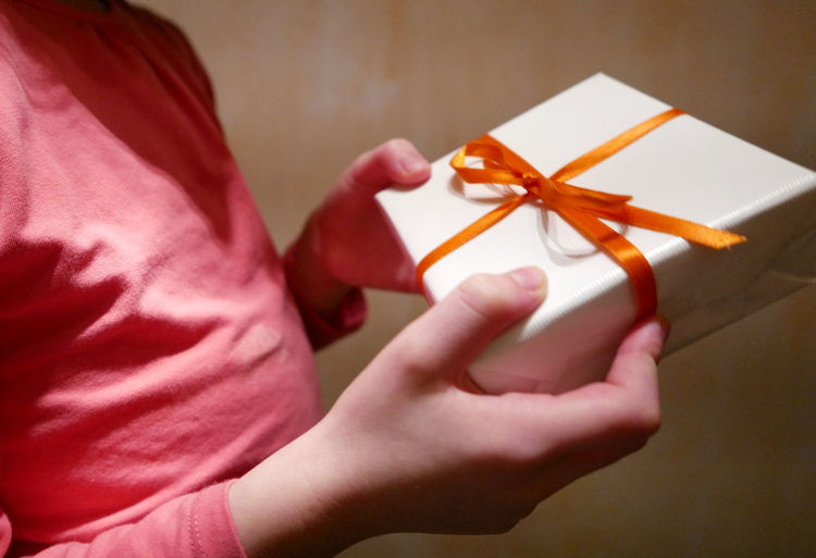 Close-Up Of Person Holding Gift