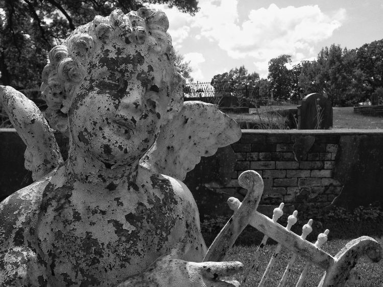 Harp Playing Cherub in Oakwood Cemetery, Montgomery, Alabama USA Sky Damaged Day Cloud - Sky Weathered Outdoors Memories No People Cemetery Photography Cemetery_shots Cherub Harp