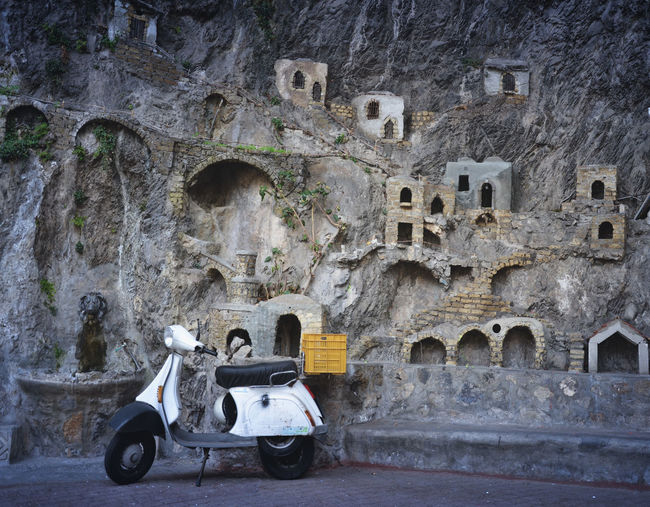 Vespa parked at the Positano crib. Vespa Scooter. Grotta di Fornillo, Positano presepe. Italy Streetphotography Amalfi Coast Ancient Civilization Cityscapes Eye4photography  EyeEm Best Edits EyeEm Best Shots EyeEm Gallery EyeEmBestPics Famous Place Gettyimages Historic Landscape Motorcycle Motorcycles Popular Photo Popular Photos Positano Showcase: February Streetphotography Taking Photos The Past Vespavintage Vintage