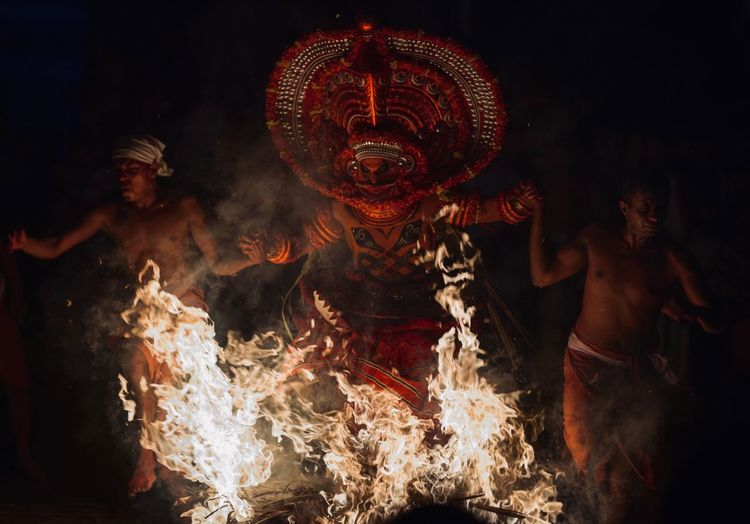 Theyyam of Kannur / Kerala - India Kerala Kerala India Indian Culture  Indian India Theyyams Of Kannur Theyyam Kannur Kannurphotos Tradition Festival Rite Arts Culture And Entertainment Motion Night Real People Celebration Illuminated Performance Burning Men Glowing Leisure Activity Group Of People Blurred Motion Fire People Lifestyles Event
