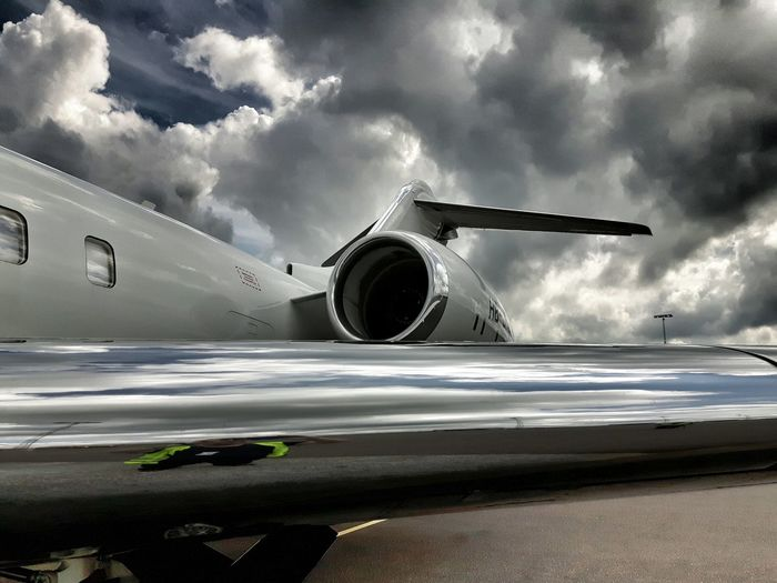 Private jet at goteborg landvetter airport runway against cloudy sky