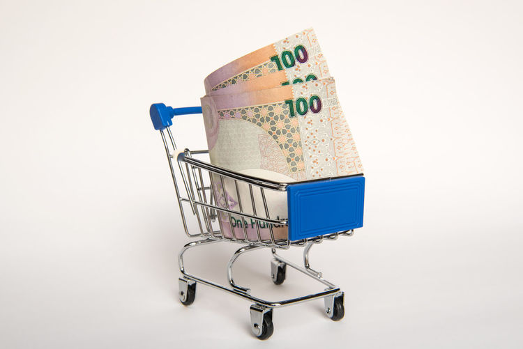 Doha Business Close-up Consumerism Container Copy Space Cut Out Economy Finance Groceries Indoors  No People Qatar Retail  Riyal Shopping Shopping Basket Shopping Cart Single Object Small Still Life Store Studio Shot Supermarket White Background