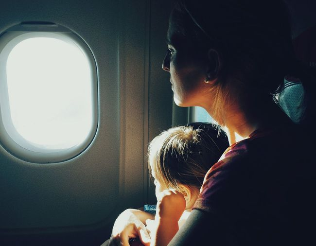 Lost in thoughts... Taking Photos Traveling Family Love Airplane Light And Shadow Sentimental Home Is Where The Art Is EyeEm Gallery EyeEm Best Edits Contrast Silent Moment Thoughtful Sunrays Warm Colors Mother & Daughter Lonely Melancholy Mobile Photography My Year My View Coming Home Capture The Moment Cinematic Shots Pivotal Ideas Two Is Better Than One Traveling Home For The Holidays Place Of Heart Let's Go. Together.