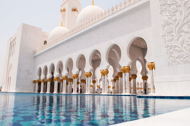 Low angle view of sheikh zayed mosque by pond