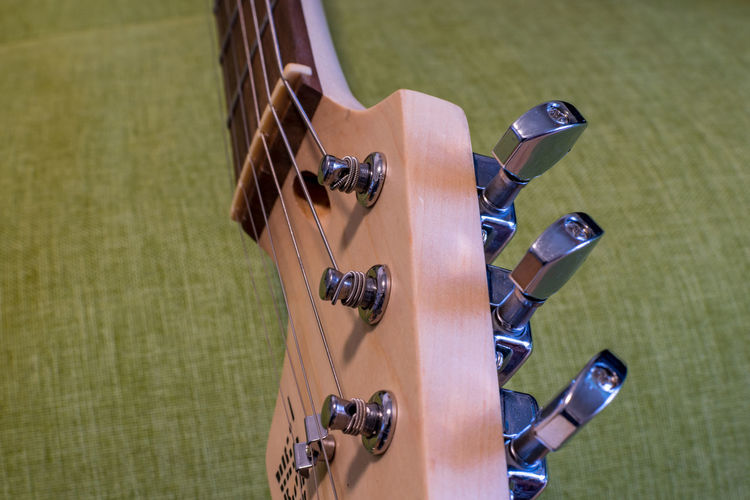 View of a guitar String Instrument Musical Instrument Musical Instrument String High Angle View Guitar Musical Equipment Arts Culture And Entertainment Focus On Foreground String Wood - Material Music No People Day Close-up Green Color Outdoors Leisure Activity Handle Sunlight