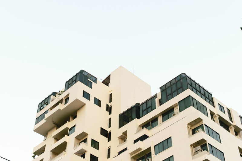 Building Exterior Built Structure Architecture Sky Building Low Angle View Clear Sky Nature No People Residential District Copy Space Day City Window Modern Outdoors White Color Apartment House Repetition Housing Development