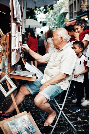 Montmartre painter... Streetphotography Street Photography Painter Painting Place Du Tertre Artist Togetherness The Street Photographer - 2018 EyeEm Awards Summer In The City