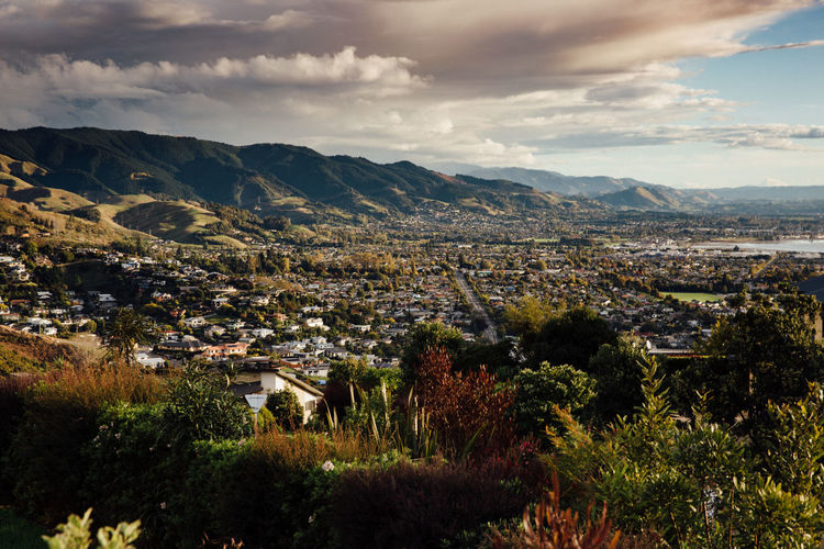 View of the city of Nelson, New Zealand. City Cityscape Cloud - Sky Community Day Dramatic Sky High Angle View Landscape Mountain Mountain Range Nature Nelson New Zealand No People Outdoors Scenic Sky Town View Weather