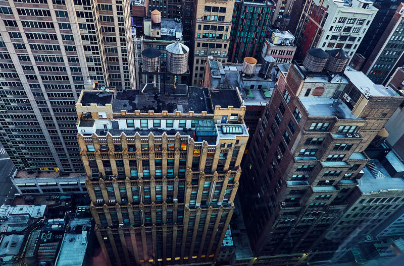 High angle view of modern buildings in city of manhattan