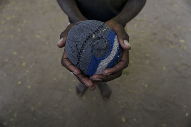 Schoolboy showing his soccer ball made by sock at School in Turkana Kenya Body Part Casual Clothing Day Finger Focus On Foreground Hand Hands Cupped High Angle View Holding Human Body Part Human Hand Land Leisure Activity Lifestyles Low Section Men Nature One Person Outdoors Real People Soccer World Cup 2018 The Still Life Photographer - 2018 EyeEm Awards The Creative - 2018 EyeEm Awards The Photojournalist - 2018 EyeEm Awards