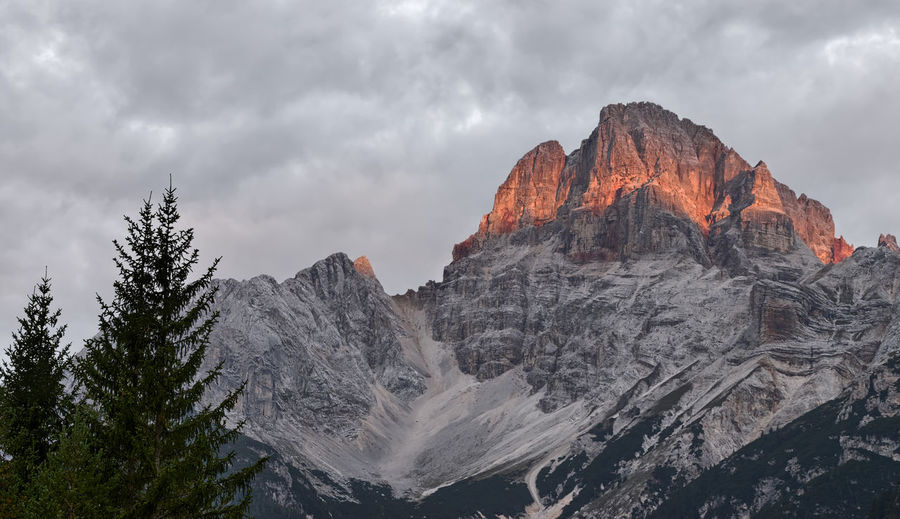 Spectacular alpenglow on the Croda Rossa Dolomites, Italy Natural Beauty Orange Red Spectacular Sunlight Alpenglow Beauty In Nature Cloud - Sky Colorful Croda Rossa Eroded Erosion Mountain Mountain Range Nature Outdoors Scenics - Nature Summit Sunlight And Shadow Sunrise Sunset Tranquil Scene Tranquility Wilderness