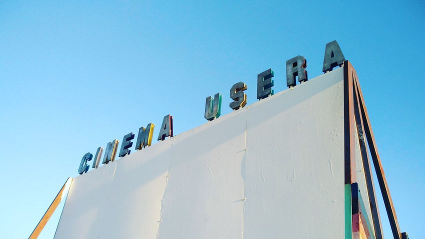 Cinema Usera Outdoors Outdoor Photography Urban Daylight Madrid SPAIN Cinema Typography Carved Wood Blue Sky Sunset EyeEm Selects Business Finance And Industry Clear Sky Sky Architecture Building Exterior Carving - Craft Product Street Art