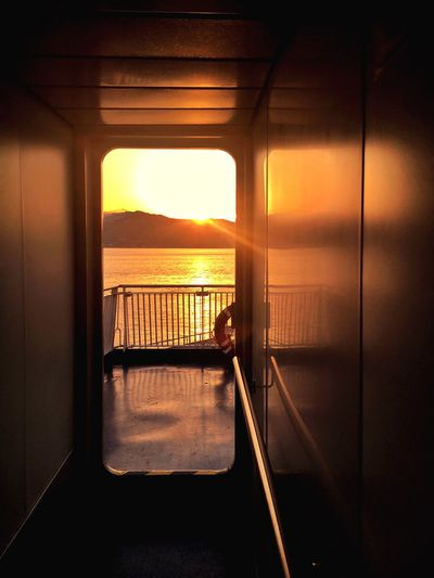 Sea Water Horizon Over Water Sunset Scenics Indoors  Sky Window Tranquil Scene Relaxation Sun Sunsets Tranquility Sunlight Home Interior Chair Built Structure Architecture Vacations Beauty In Nature Luxury Ship Caronte & Tourist Nave... Strait Messina