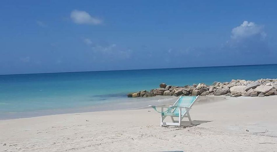 Beach Sand Sea Chair Relaxation Sky Summer Vacations Tranquility Outdoor Chair Travel Destinations No People Day Nature Water Travel Tropical Climate Antigua And Barbuda Sommergefühle The Week On EyeEm