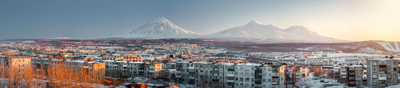 Panorama of Petropavlovsk-Kamchatsky cityscape and Koryaksky volcano at sunrise. Far East, Russia Active Volcano Beauty In Nature City Cityscape Early Morning Far East Houses Kamchatka Kamchatka Krai Koryaksky Volcano Landscape Mountain Range Nature Outdoors Panorama Petropavlovsk-Kamchatskiy Residential Building Russia Sky Snow Sunrise TOWNSCAPE Urban Landscape Volcano Winter