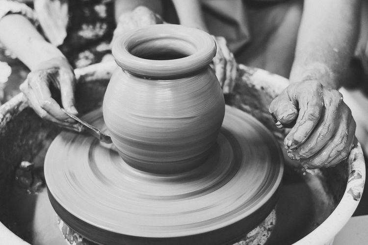 Art And Craft Artist Clay Close-up Craft Craftsperson Creativity Day Earthenware Expertise Human Body Part Human Hand Making Molding A Shape Motion Mud Occupation One Person Pottery Real People Shape Skill  Spinning Working Workshop