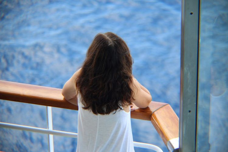 EyeEm Selects Cruise Ship Rear View One Person Railing Real People Day Women Outdoors Girls Sitting Lifestyles Water Sea Nautical Vessel Childhood Sky Nature Close-up People The Week On EyeEm EyeEmNewHere EyeEm Nature Lover EyeEm Gallery Investing In Quality Of Life