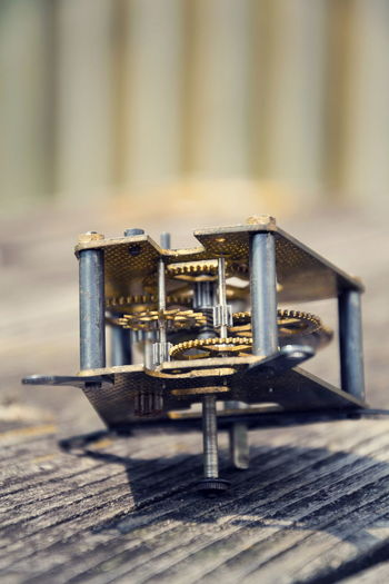 Close-up of old machine part on table