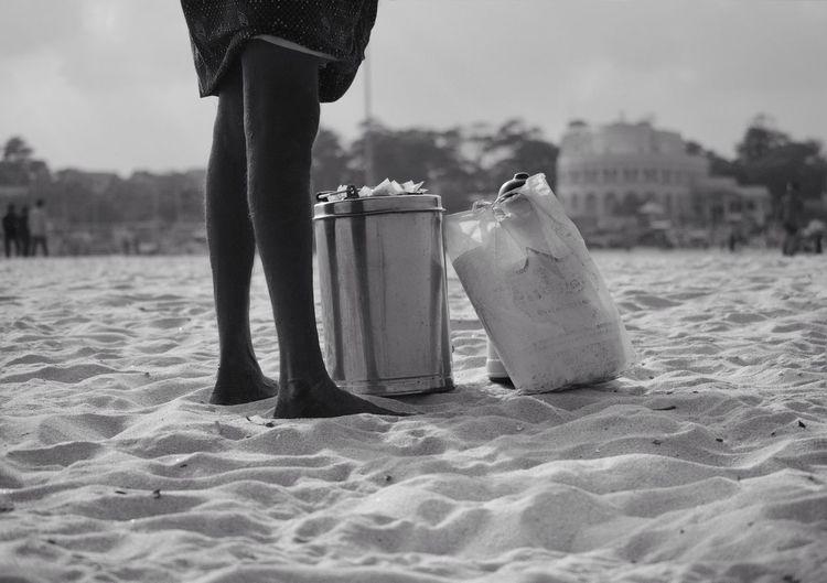 A tea seller taking a break on the vast beach.