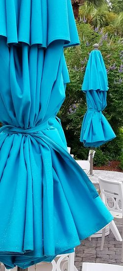 Turquoise Blue Umbrella Umbrellas Tables Tables And Chairs Outdoors Textures And Surfaces Hilton Head Island, SC Hilton Head Island Hilton Head SC Colignyplaza Coligny Closed Umbrella Wrinkles Bunched Tied Rain Raindrops Texture Beach Patio