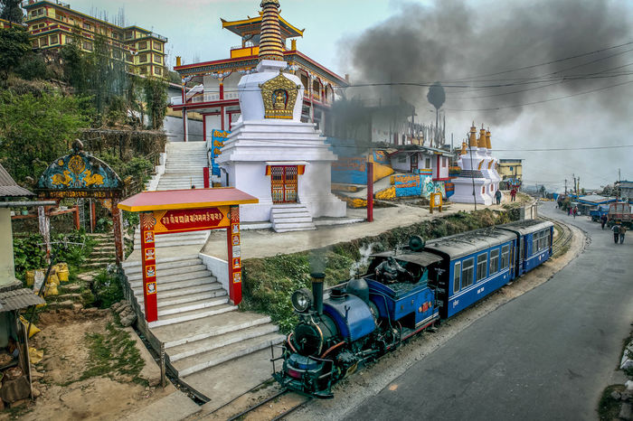 No People Tree Outdoors Sky Architecture Day Train Toy Train Rail Transport Engine Steem Engine Heritage World Heritage India Monestry Stupa Buddhism Smoke Technology Streetphotography Darjeeling Himalayan Railway Darjeeling Rail Darjeeling West Bangal